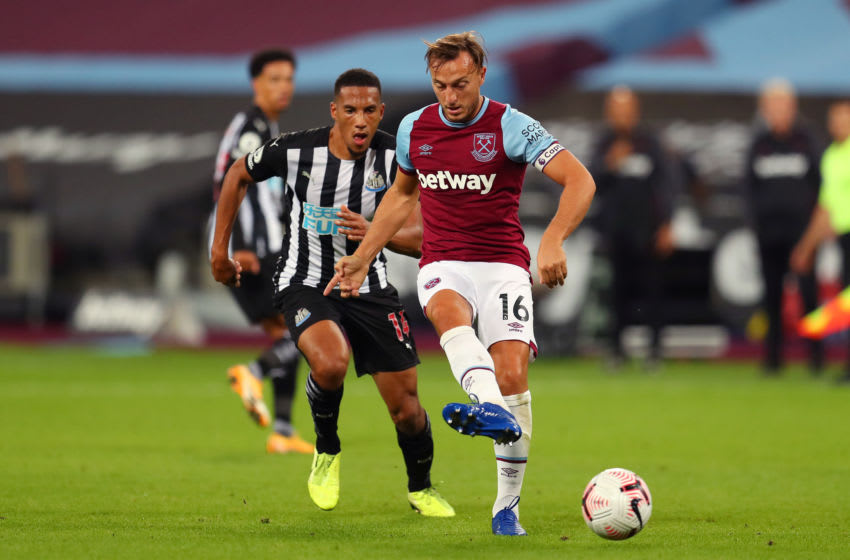 LONDON, ENGLAND - SEPTEMBER 12: Mark Noble of West Ham United passes the ball during the Premier League match between West Ham United and Newcastle United at London Stadium on September 12, 2020 in London, England. (Photo by Catherine Ivill/Getty Images)