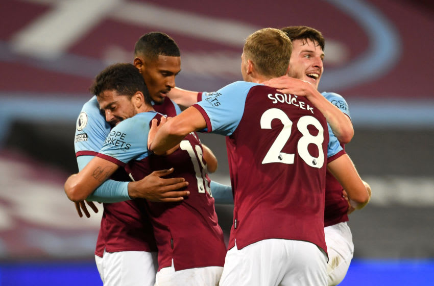 LONDON, ENGLAND - SEPTEMBER 27: Sebastian Haller of West Ham United celebrates with teammates after scoring his sides fourth goal during the Premier League match between West Ham United and Wolverhampton Wanderers at London Stadium on September 27, 2020 in London, England. Sporting stadiums around the UK remain under strict restrictions due to the Coronavirus Pandemic as Government social distancing laws prohibit fans inside venues resulting in games being played behind closed doors. (Photo by Andy Rain - Pool/Getty Images)