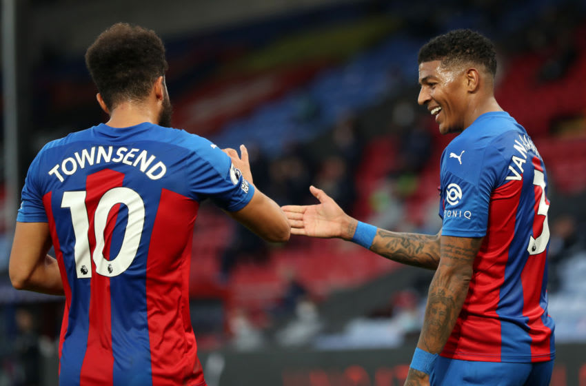 Patrick van Aanholt of Crystal Palace celebrates with teammate Andros Townsend. (Photo by Naomi Baker/Getty Images)