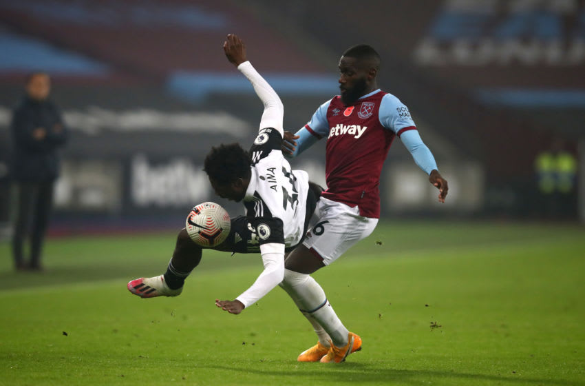 LONDON, ENGLAND - NOVEMBER 07: Ola Aina of Fulham is challenged by Arthur Masuaku of West Ham United (Photo by Julian Finney/Getty Images)
