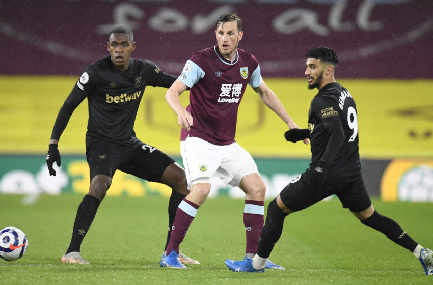 Chris Wood of Burnley battles for possession with Issa Diop and Said Benrahma of West Ham. (Photo by Peter Powell - Pool/Getty Images)