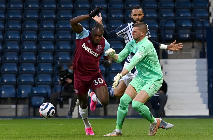 Michail Antonio of West Ham United is fouled by Sam Johnstone of West Bromwich Albion. (Photo by Shaun Botterill/Getty Images)