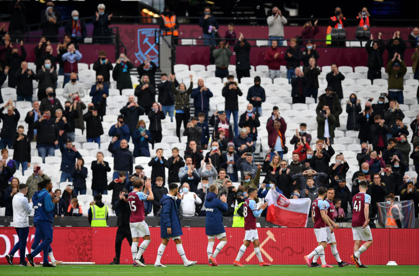 Players and fans of West Ham United celebrate. (Photo by Justin Tallis - Pool/Getty Images)