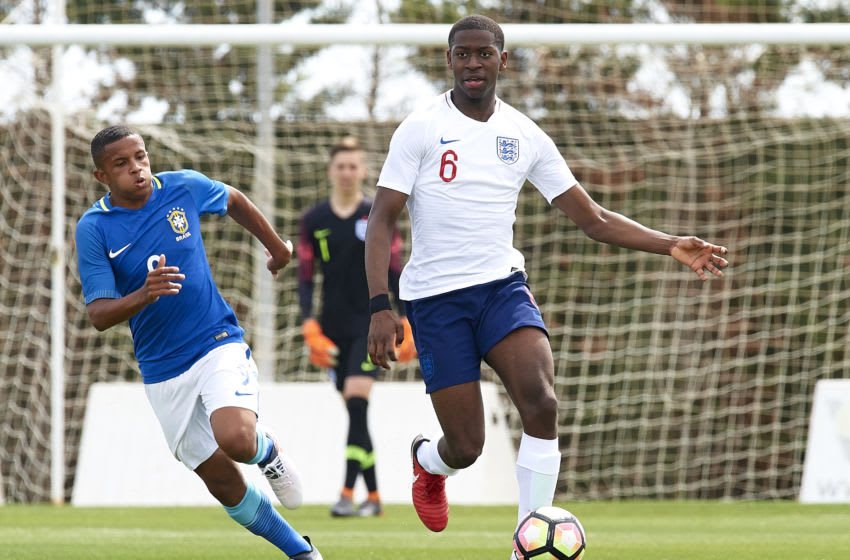 MURCIA, SPAIN - MARCH 23: Paulo Oliveira of Brazil chases down Aji Alese of England during the international friendly match between England U17 and Brazil U17 at Pinatar Arena on March 23, 2018 in Murcia, Spain. (Photo by Quality Sport Images/Getty Images)