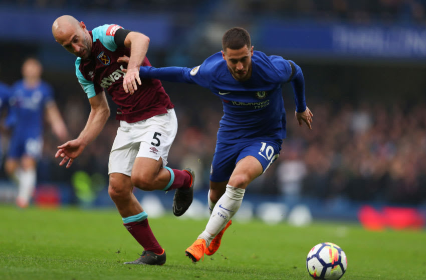 LONDON, ENGLAND - APRIL 08: Pablo Zabaleta of West Ham United tries to stop Eden Hazard of Chelsea during the Premier League match between Chelsea and West Ham United at Stamford Bridge on April 8, 2018 in London, England. (Photo by Catherine Ivill/Getty Images)
