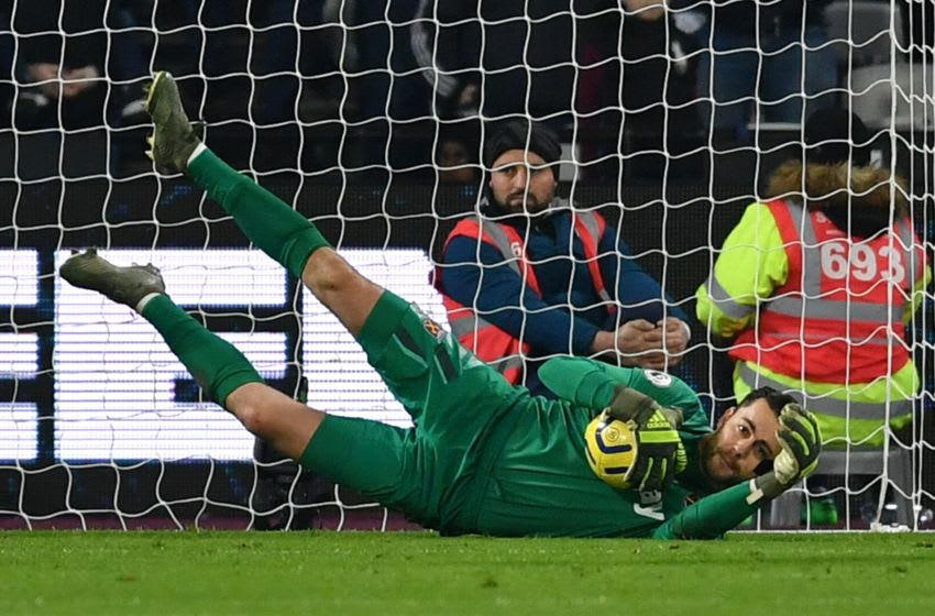 West Ham United's Polish goalkeeper Lukasz Fabianski makes a save during the English Premier League football match between West Ham United and Leicester City at The London Stadium, in east London on December 28, 2019. (Photo by Ben STANSALL / AFP) / RESTRICTED TO EDITORIAL USE. No use with unauthorized audio, video, data, fixture lists, club/league logos or 'live' services. Online in-match use limited to 120 images. An additional 40 images may be used in extra time. No video emulation. Social media in-match use limited to 120 images. An additional 40 images may be used in extra time. No use in betting publications, games or single club/league/player publications. / (Photo by BEN STANSALL/AFP via Getty Images)