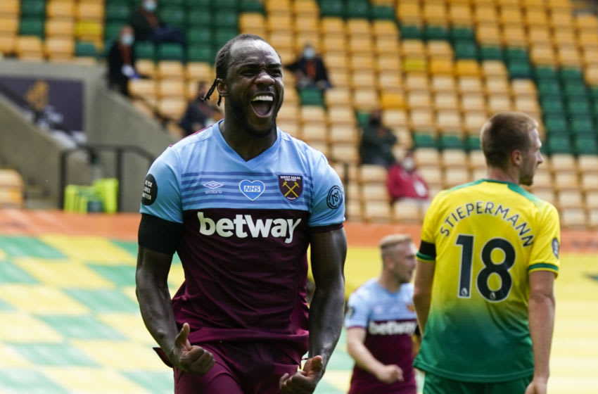 West Ham United's English midfielder Michail Antonio celebrates after scoring a goal during the English Premier League football match between Norwich City and West Ham United at Carrow Road in Norwich, eastern England on July 11, 2020. (Photo by Tim Keeton / POOL / AFP) / RESTRICTED TO EDITORIAL USE. No use with unauthorized audio, video, data, fixture lists, club/league logos or 'live' services. Online in-match use limited to 120 images. An additional 40 images may be used in extra time. No video emulation. Social media in-match use limited to 120 images. An additional 40 images may be used in extra time. No use in betting publications, games or single club/league/player publications. / ALTERNATIVE CROP (Photo by TIM KEETON/POOL/AFP via Getty Images)