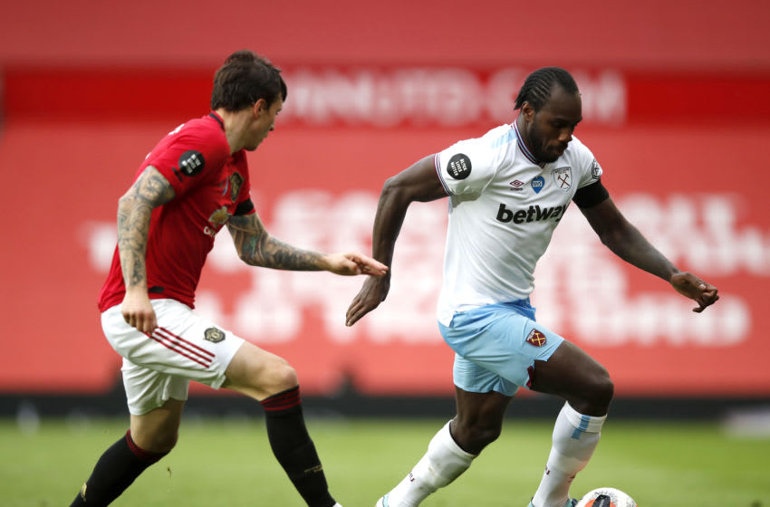 MANCHESTER, ENGLAND - JULY 22: Michail Antonio of West Ham United runs with the ball during the Premier League match between Manchester United and West Ham United at Old Trafford on July 22, 2020 in Manchester, England. Football Stadiums around Europe remain empty due to the Coronavirus Pandemic as Government social distancing laws prohibit fans inside venues resulting in all fixtures being played behind closed doors. (Photo by Clive Brunskill/Getty Images)