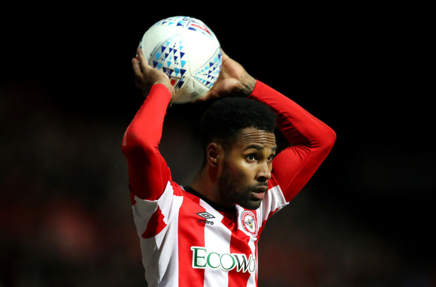 BRENTFORD, ENGLAND - DECEMBER 11: Rico Henry of Brentford takes a throw-in during the Sky Bet Championship match between Brentford and Cardiff City at Griffin Park on December 11, 2019 in Brentford, England. (Photo by Alex Pantling/Getty Images)