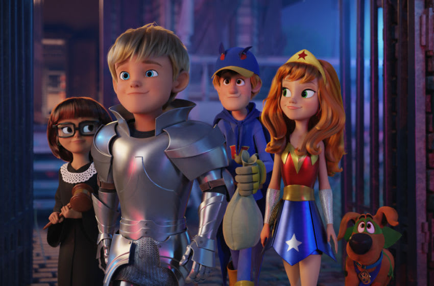 """(L-r) Young Velma voiced by ARIANA GREENBLATT, Young Fred voiced by PIERCE GAGNON, Young Shaggy voiced by IAIN ARMITAGE, Young Daphne voiced by MCKENNA GRACE and Scooby-Doo voiced by FRANK WELKER in the new animated adventure """"SCOOB!"""" from Warner Bros. Pictures and Warner Animation Group. Courtesy of Warner Bros. Pictures"""