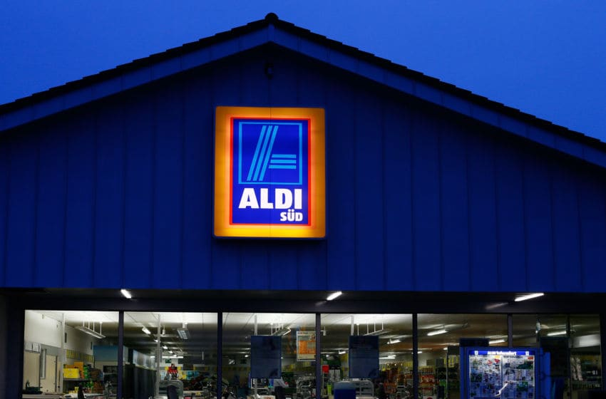 RUESSELSHEIM, GERMANY - APRIL 8: A sign hangs on an Aldi store on April 8, 2013 in Ruesselsheim near Frankfurt, Germany. Aldi, which today is among the world's most successful discount grocery store chains, will soon mark its 100th anniversary and traces its history back to Karl Albrecht, who began selling baked goods in Essen on April 10, 1913 and founded the Aldi name by shortening the phrase Albrecht Discount. His sons Karl Jr. and Theo expanded the chain dramatically, creating 300 stores by 1960 divided between northern and southern Germany, with Aldi Nord and Aldi Sued, respectively. Today the two chains have approximately 4,300 stores nationwide and have also expanded into other countries across Europe and the USA. Aldi Nord operates in the USA under the name Trader Joe's. (Photo by Ralph Orlowski/Getty Images)