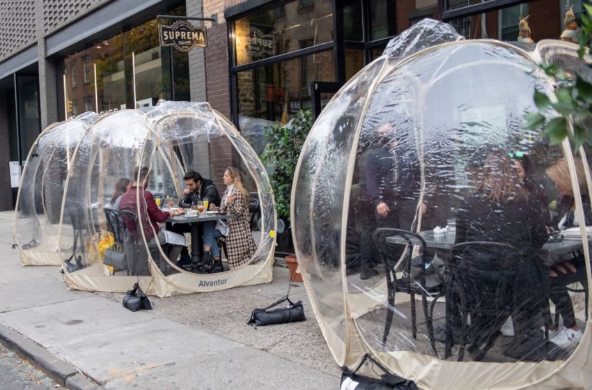 NEW YORK, NEW YORK - OCTOBER 25: People dine outdoors in plastic bubbles at Suprema Provisions on October 25, 2020 in New York City. Restaurants are finding ways to extend the outdoor dining season as long as possible by adding plastic bubbles, outdoor heaters and plexiglass tents. The pandemic continues to burden restaurants and bars as businesses struggle to thrive with evolving government restrictions and social distancing plans which impact keeping businesses open yet challenge profitability. (Photo by Alexi Rosenfeld/Getty Images)