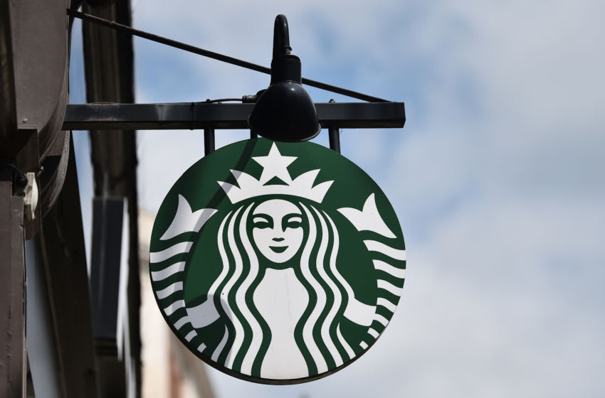 LEEDS, ENGLAND - MAY 27: The American Coffeehouse company, Starbucks logo is displayed outside one of its stores on May 27, 2021 in Leeds, England. (Photo by Nathan Stirk/Getty Images)
