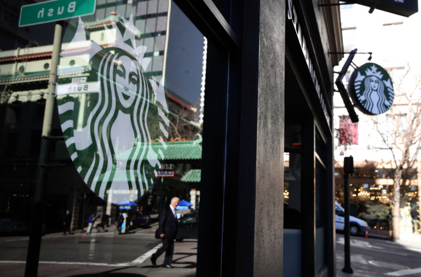 SAN FRANCISCO, CALIFORNIA - JANUARY 24: The Starbucks logo is displayed in the window of a Starbucks Coffee shop on January 24, 2019 in San Francisco, California. Starbucks will report first quarter earnings after today's closing bell. (Photo by Justin Sullivan/Getty Images)