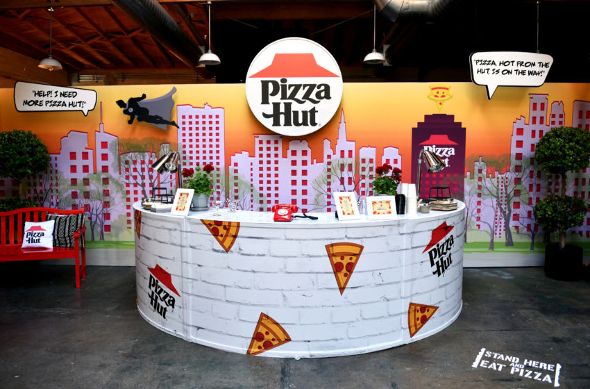 SAN DIEGO, CALIFORNIA - JULY 20: Pizza Hut lounge and branding is seen during the Pizza Hut Lounge at 2019 Comic-Con International: San Diego on July 20, 2019 in San Diego, California. (Photo by Presley Ann/Getty Images for Pizza Hut)