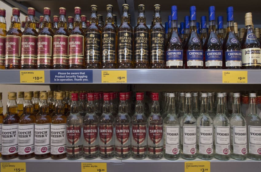 CARDIFF, UNITED KINGDOM - SEPTEMBER 17: Bottles of alcohol on sale in a UK supermarket on September 17, 2015 in Cardiff, United Kingdom. A new law setting a minimum alcohol price came into force on March 2 under Welsh Government plans. Retailers and bars have to charge a minimum of 50p per unit, meaning a can of cider could cost at least £1 and a bottle of wine £4.69. A similar system in Scotland has seen alcohol sales fall to the lowest levels since records began. (Photo by Matthew Horwood/Getty Images)
