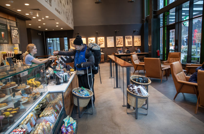 SEATTLE, WASHINGTON - MARCH 10: A Starbucks coffee shop sits mostly empty at Amazon headquarters on March 10, 2020 in downtown Seattle, Washington. In response to the coronavirus outbreak, Amazon recommended all employees in its Seattle headquarters work from home, leaving much of downtown nearly void of people. (Photo by John Moore/Getty Images)