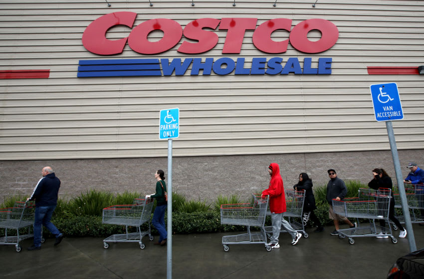 NOVATO, CALIFORNIA - MARCH 14: Customers wait in line to enter a Costco store on March 14, 2020 in Novato, California. Some Americans are stocking up on food, toilet paper, water and other items after the World Health Organization (WHO) declared Coronavirus (COVID-19) a pandemic. (Photo by Justin Sullivan/Getty Images)