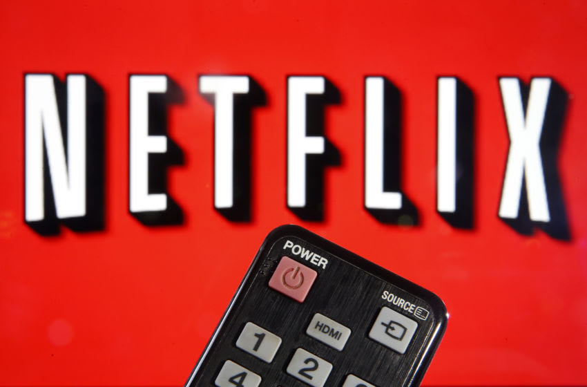 In this photo illustration, a remote control is seen in front of a television screen showing a Netflix logo on March 28, 2020 in Paris, France. Faced with the coronavirus crisis, Netflix will reduce visual quality for the next 30 days, in order to limit its use of bandwidth. (Photo Illustration by Chesnot/Getty Images)