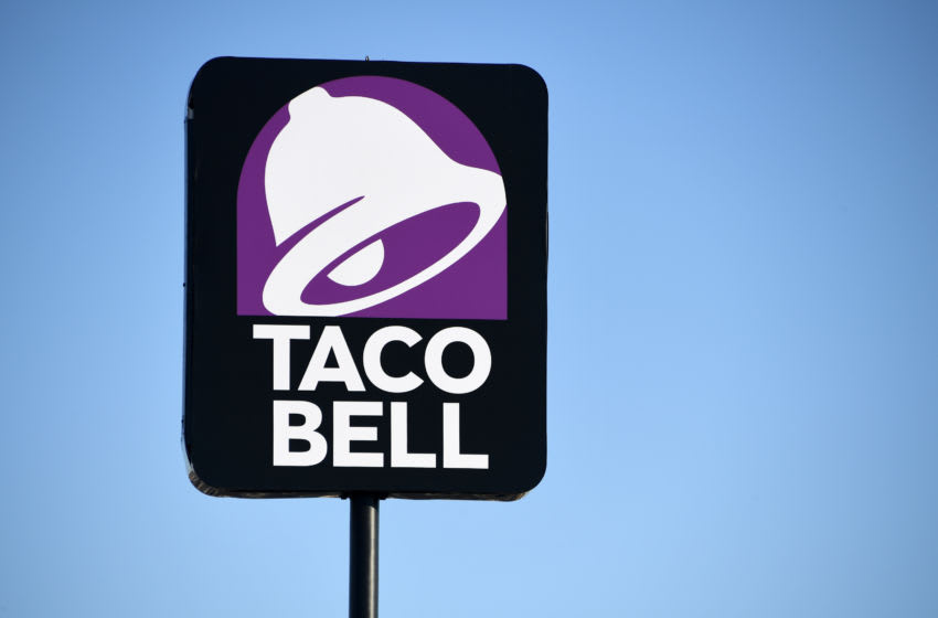 LAS VEGAS, NEVADA - MARCH 30: An exterior view shows a sign at a Taco Bell restaurant on March 30, 2020 in Las Vegas, Nevada. Taco Bell Corp. announced that on March 31, 2020, the company will give everyone in the country one free beef nacho cheese Doritos Locos Taco, no purchase necessary, to drive-thru customers at participating locations while supplies last as a way of thanking people who are helping their communities in the wake of the coronavirus pandemic. The company also announced it would relaunch its Round Up program, which gives customers the option to