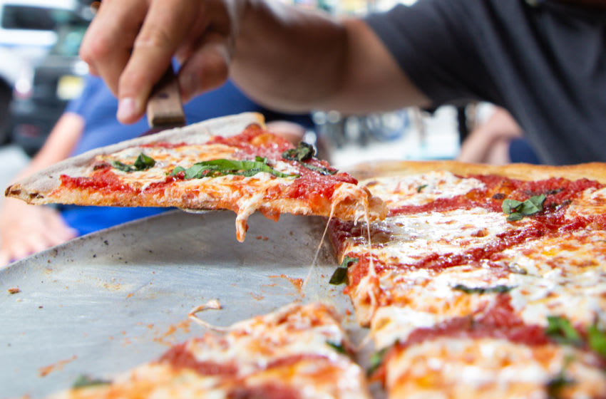 NEW YORK, NEW YORK - JULY 07: A Margherita pie is seen served at the famous Lombardi's Pizza amid the COVID-19 pandemic on July 07, 2020 in New York, New York. In 1905, Lombardi's Pizza was recognized as the First Pizzeria in the United States. Amid the coronavirus pandemic, Lombardi's has reopened its doors once again. (Photo by Arturo Holmes/Getty Images)
