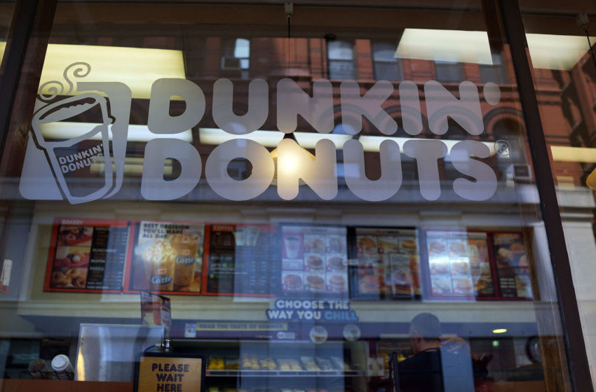 NEW YORK, NY - AUGUST 26: A sign for a Dunkin' Donuts store is viewed on August 26, 2013 in New York City. Due to minimum wage and overtime violations, the U.S. Labor Department announced that the operator of 55 Dunkin' Donuts franchises in both New Jersey and on New York's Staten Island will have to pay 64 employees nearly $200,000 in back wages. (Photo by Spencer Platt/Getty Images)