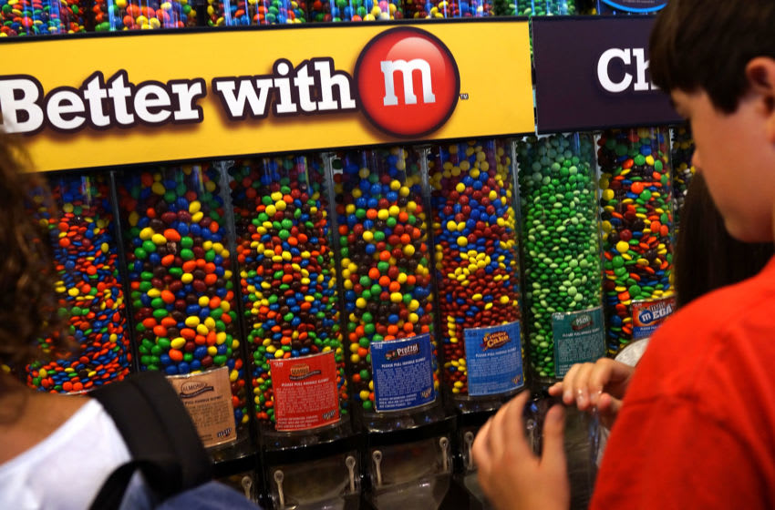 NEW YORK, NY - JULY 24: People visit the M&M store in Times Square on July 24, 2014 in New York City. With the increase in cocoa prices, Mars Chocolate North America, the maker of Snickers and M&M's, announced an average price increase of 7 percent this week for their chocolate products. (Photo by Spencer Platt/Getty Images)
