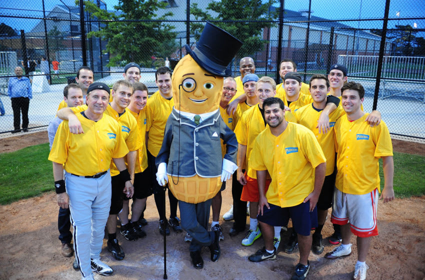 WINNETKA, IL - AUGUST 06: MLB Hall of Famer Frank Thomas and Mr. Peanut pose with the Chiefs softball team following the Planters Power Hitter Event at the Skokie Playfields on August 6, 2014 in Winnetka, Illinois. (Photo by Timothy Hiatt/Getty Images for Planters)