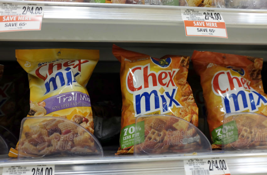 MIAMI, FL - SEPTEMBER 23: General Mills Chex Mix are displayed on a store shelf on September 23, 2014 in Miami, Florida. During a share holders meeting tomorrow, General Mills investors are being given the opportunity to vote on whether the company should remove genetically modified organisms from its products. (Photo by Joe Raedle/Getty Images)