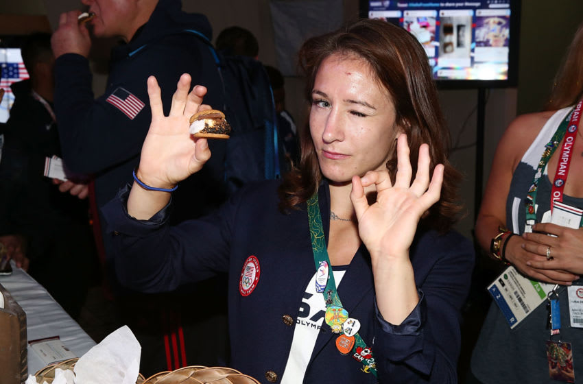 RIO DE JANEIRO, BRAZIL - AUGUST 10: U.S. Olympian Marti Malloy enjoys a S'more at Hershey's National S'mores Day Party at USA House on August 10, 2016 in Rio de Janeiro, Brazil. (Photo by Joe Scarnici/Getty Images for Hershey )