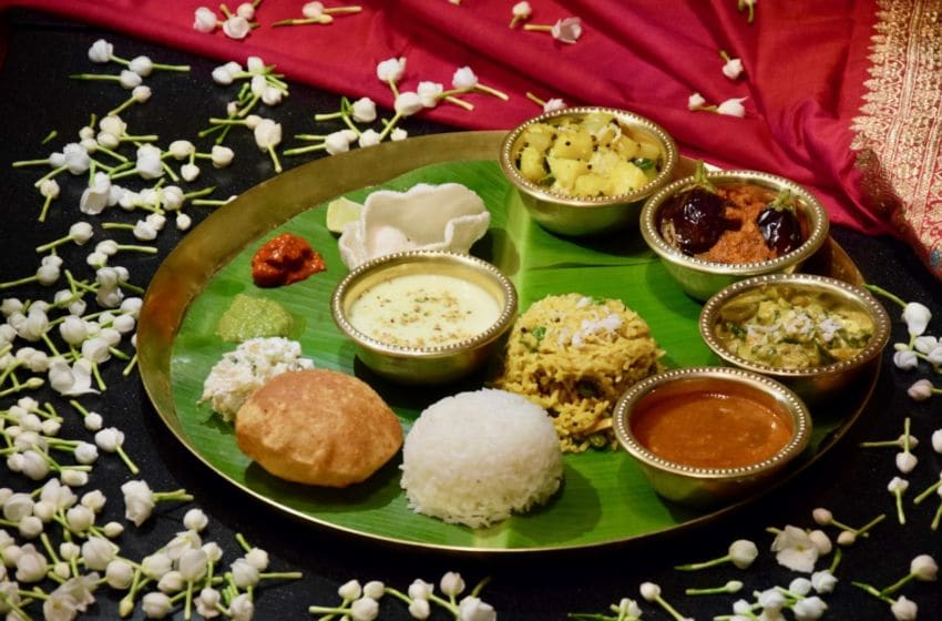 MUMBAI, INDIA - OCTOBER 08: A traditional Maharashtrian vegetarian thali, where each food item is placed anti-clockwise on it, starting from the left to the right, prepared by Chef De Cuisine Dinesh Joshi at the Lost Recipes of Maharashtra Food Festival at Tiqri at Taj Santacruz on October 8, 2017 in Mumbai, India. (Photo by Rubina A. Khan/Getty Images)