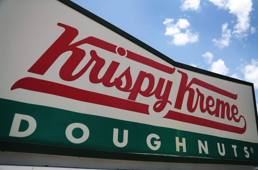 MIAMI, FL - MAY 09: A Krispy Kreme Donuts sign is seen outside of a store on May 09, 2016 in Miami, Florida. JAB Holdings Company, announced it is acquiring Krispy Kreme Donuts in a deal valued at $1.35 billion. (Photo by Joe Raedle/Getty Images)
