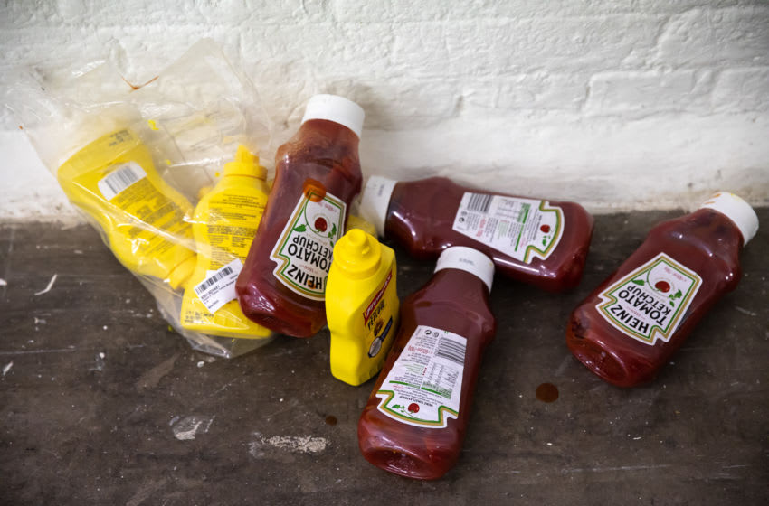 LONDON, ENGLAND - FEBRUARY 15: Discarded Ketchup and Mustard bottles used to add design to a model backstage ahead of the Fashion East show during London Fashion Week February 2020 on February 15, 2020 in London, England. (Photo by Tim Whitby/BFC/Getty Images)