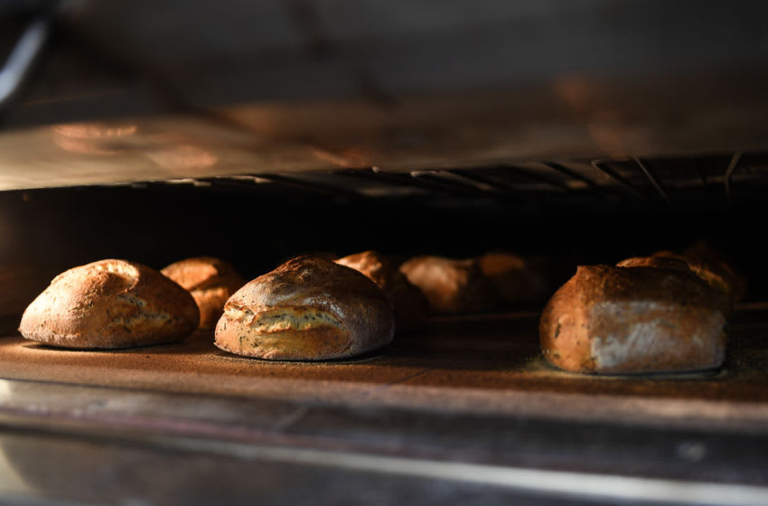 LONDON, ENGLAND - APRIL 14: Bread is seen baking in an oven at The Bread Factory on April 14, 2020 in London, England. During the COVID-19 outbreak and lockdown, the bakery-and-cafe chain says it is providing 2400 meals per week to hospitals in neighborhoods near some of its 50 London stores. It also continues to operate a home delivery business and allows takeaway orders at some locations. (Photo by Peter Summers/Getty Images)
