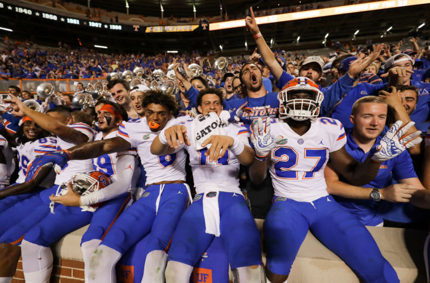 KNOXVILLE, TN - SEPTEMBER 22: Trevon Grimes #8 of the Florida Gators, Feleipe Franks #13 of the Florida Gators, and Dameon Pierce #27 of the Florida Gators celebrates the win with the fans after the game between the Florida Gators and Tennessee Volunteers at Neyland Stadium on September 22, 2018 in Knoxville, Tennessee. Florida won the game 47-21. (Photo by Donald Page/Getty Images)