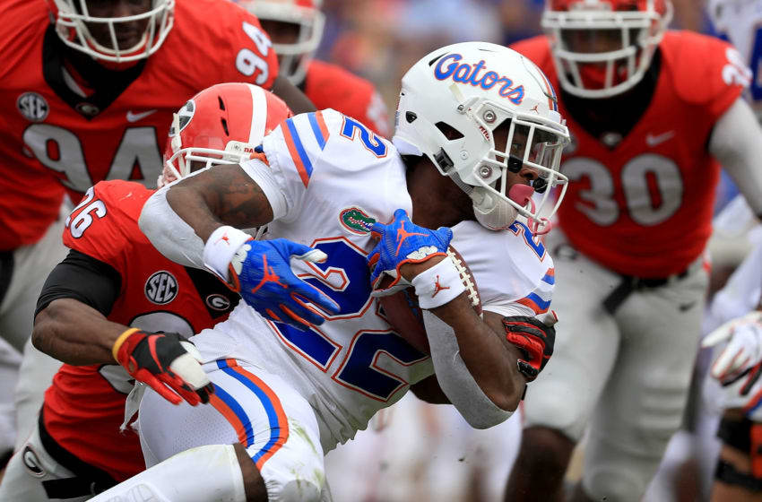 JACKSONVILLE, FL - OCTOBER 27: Lamical Perine #22 of the Florida Gators rushes during a game against the Georgia Bulldogs at TIAA Bank Field on October 27, 2018 in Jacksonville, Florida. (Photo by Mike Ehrmann/Getty Images)
