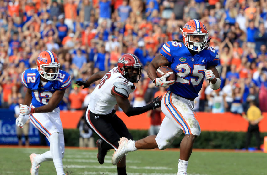 GAINESVILLE, FLORIDA - NOVEMBER 10: Jordan Scarlett #25 of the Florida Gators rushes for yardage during the game against the South Carolina Gamecocks at Ben Hill Griffin Stadium on November 10, 2018 in Gainesville, Florida. (Photo by Sam Greenwood/Getty Images)