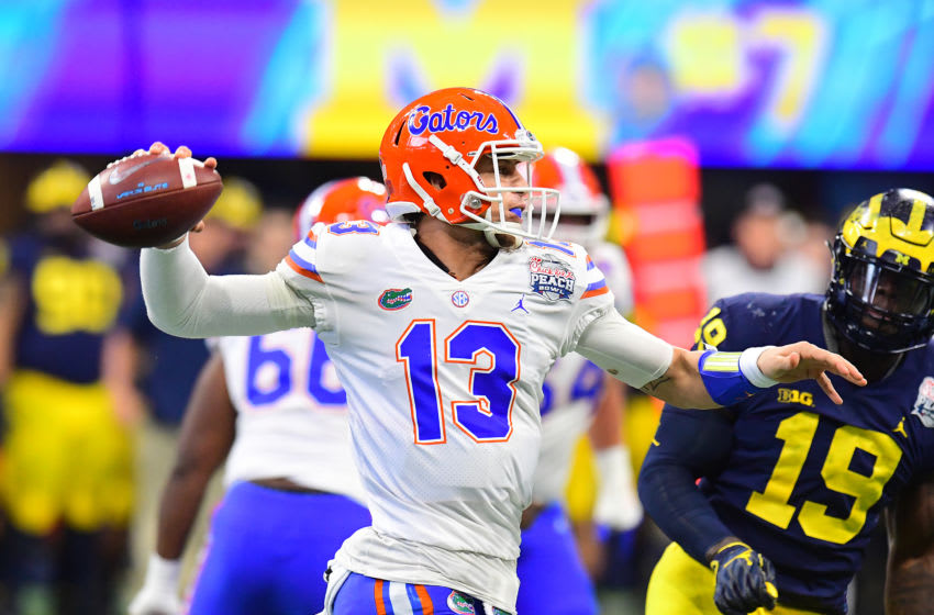 ATLANTA, GEORGIA - DECEMBER 29: Feleipe Franks #13 of the Florida Gators looks to pass against the Michigan Wolverines in the first quarter during the Chick-fil-A Peach Bowl at Mercedes-Benz Stadium on December 29, 2018 in Atlanta, Georgia. (Photo by Scott Cunningham/Getty Images)