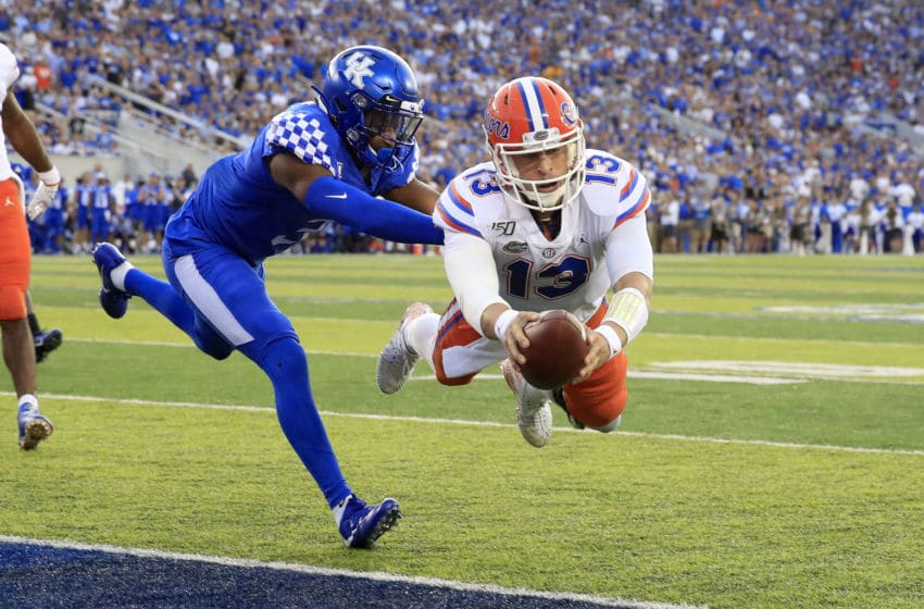 LEXINGTON, KENTUCKY - SEPTEMBER 14: Feleipe Franks #13 of the Florida Gators dives for the goal line against the Kentucky Wildcats at Commonwealth Stadium on September 14, 2019 in Lexington, Kentucky. (Photo by Andy Lyons/Getty Images)