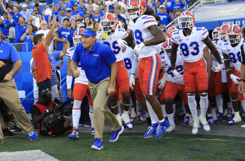 LEXINGTON, KENTUCKY - SEPTEMBER 14: Dan Mullen the head coach of the Florida Gators leads his team on the field before the game against the Kentucky Wildcats at Commonwealth Stadium on September 14, 2019 in Lexington, Kentucky. (Photo by Andy Lyons/Getty Images)
