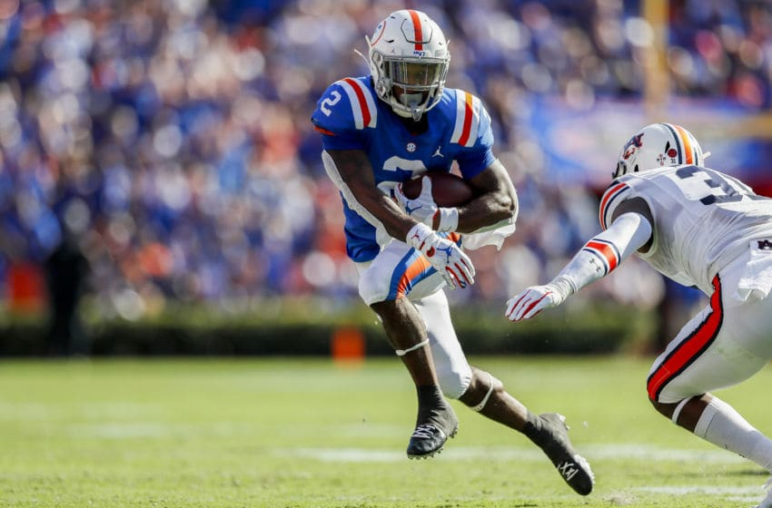 GAINESVILLE, FLORIDA - OCTOBER 05: Lamical Perine #2 of the Florida Gators runs for yardage during the second quarter of a game against the Auburn Tigers at Ben Hill Griffin Stadium on October 05, 2019 in Gainesville, Florida. (Photo by James Gilbert/Getty Images)