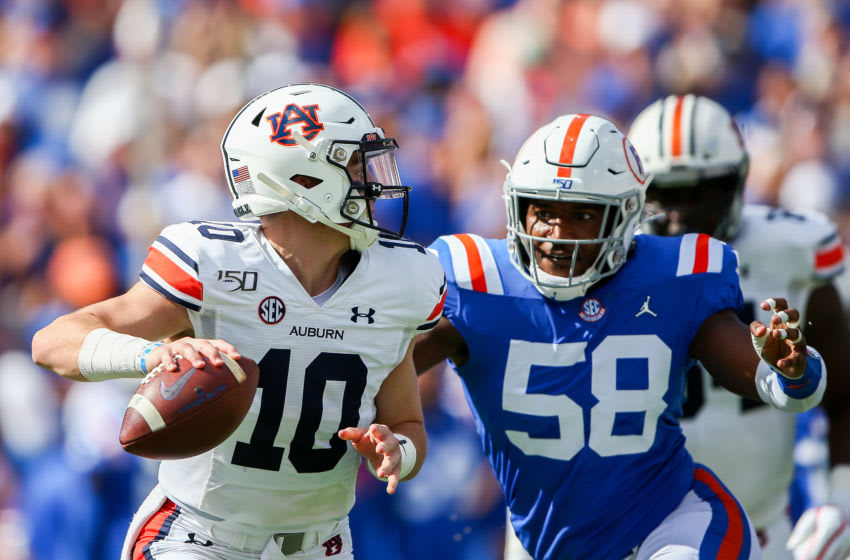 GAINESVILLE, FLORIDA - OCTOBER 05: Bo Nix #10 of the Auburn Tigers is pressured by Jonathan Greenard #58 of the Florida Gators during the first quarter of a game at Ben Hill Griffin Stadium on October 05, 2019 in Gainesville, Florida. (Photo by James Gilbert/Getty Images)