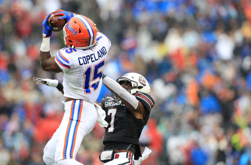COLUMBIA, SOUTH CAROLINA - OCTOBER 19: Jacob Copeland #15 of the Florida Gators makes a catch over Dakereon Joyner #7 of the South Carolina Gamecocks during their game at Williams-Brice Stadium on October 19, 2019 in Columbia, South Carolina. (Photo by Streeter Lecka/Getty Images)