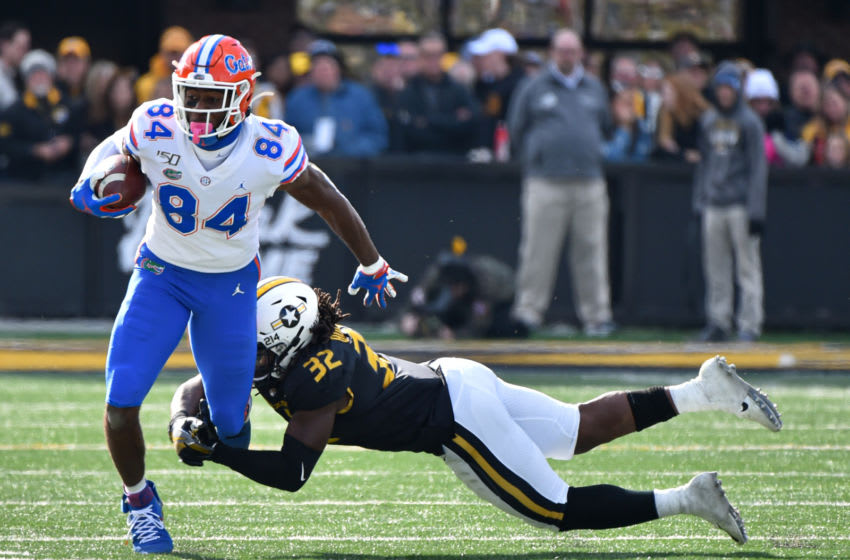 COLUMBIA, MISSOURI - NOVEMBER 16: Tight end Kyle Pitts #84 of the Florida Gators tries to avoid a tackle by linebacker Nick Bolton #32 of the Missouri Tigers second quarter at Faurot Field/Memorial Stadium on November 16, 2019 in Columbia, Missouri. (Photo by Ed Zurga/Getty Images)