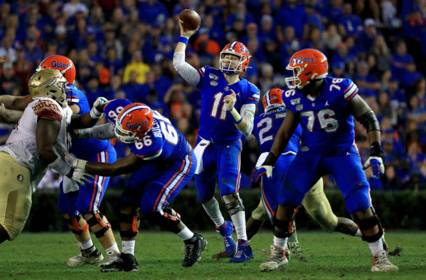 GAINESVILLE, FLORIDA - NOVEMBER 30: Kyle Trask #11 of the Florida Gators passes during a game against the Florida State Seminoles at Ben Hill Griffin Stadium on November 30, 2019 in Gainesville, Florida. (Photo by Mike Ehrmann/Getty Images)