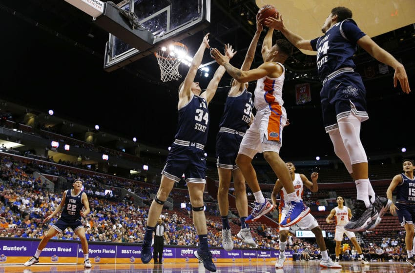 SUNRISE, FLORIDA - DECEMBER 21: Keyontae Johnson #11 of the Florida Gators shot is blocked by Trevin Dorius #32 of the Utah State Aggies during the first half of the Orange Bowl Basketball Classic at BB&T Center on December 21, 2019 in Sunrise, Florida. (Photo by Michael Reaves/Getty Images)