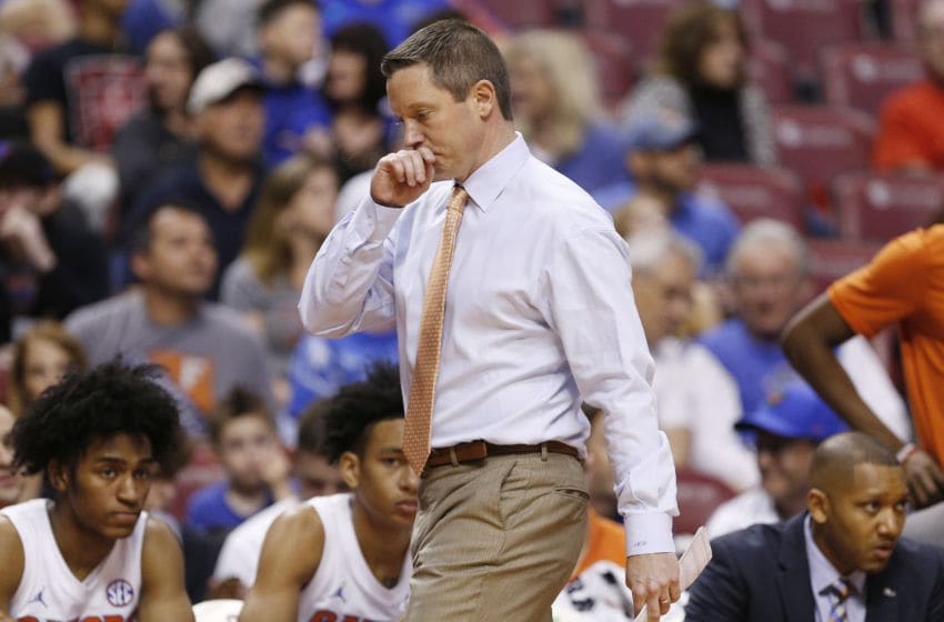 SUNRISE, FLORIDA - DECEMBER 21: Head coach Mike White of the Florida Gators reacts against the Utah State Aggies during the second half of the Orange Bowl Basketball Classic at BB&T Center on December 21, 2019 in Sunrise, Florida. (Photo by Michael Reaves/Getty Images)