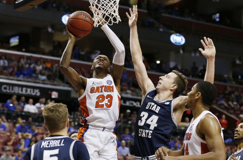 SUNRISE, FLORIDA - DECEMBER 21: Scottie Lewis #23 of the Florida Gators shoots against Justin Bean #34 of the Utah State Aggies during the second half of the Orange Bowl Basketball Classic at BB&T Center on December 21, 2019 in Sunrise, Florida. (Photo by Michael Reaves/Getty Images)