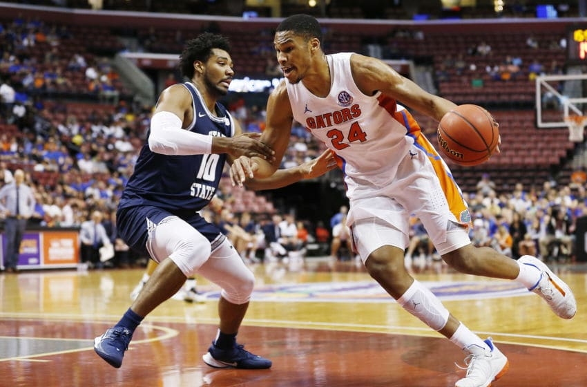 SUNRISE, FLORIDA - DECEMBER 21: Kerry Blackshear Jr. #24 of the Florida Gators drives to the basket against Alphonso Anderson #10 of the Utah State Aggies during the second half of the Orange Bowl Basketball Classic at BB&T Center on December 21, 2019 in Sunrise, Florida. (Photo by Michael Reaves/Getty Images)