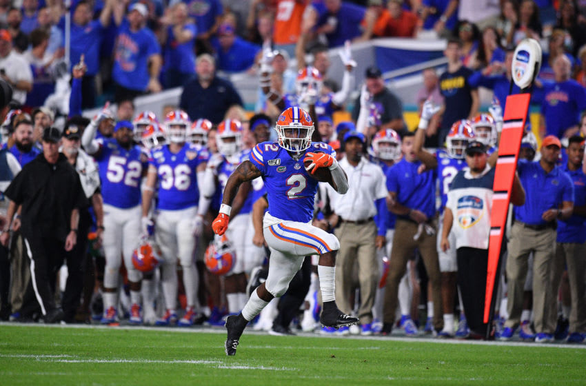 MIAMI, FLORIDA - DECEMBER 30: Lamical Perine #2 of the Florida Gators runs for a touchdown in the first half the Capital One Orange Bowl against the Virginia Cavaliers at Hard Rock Stadium on December 30, 2019 in Miami, Florida. (Photo by Mark Brown/Getty Images)